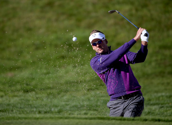 Ian Poulter, who boasts a 12-3-0 overall record at the Ryder Cup, plays from a bunker on the 10th hole.