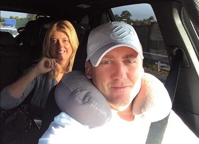 Ian Poulter and his wife Katie head to the airport after a long night of partying European-style.