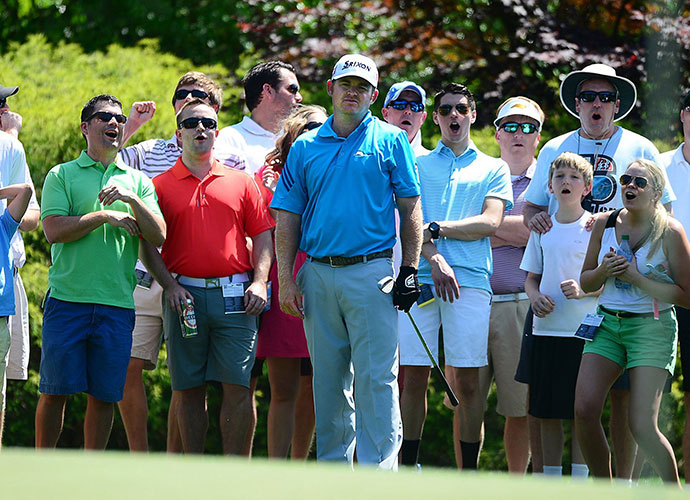 The gallery reacts to Holmes' birdie attempt on the sixth green.