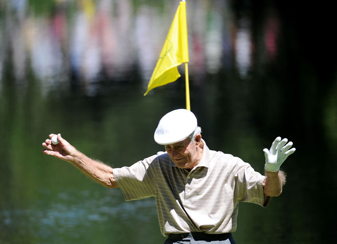 Jack Fleck walks off a green during the par 3 contest prior to the 2011 Masters Tournament at Augusta National Golf Club.