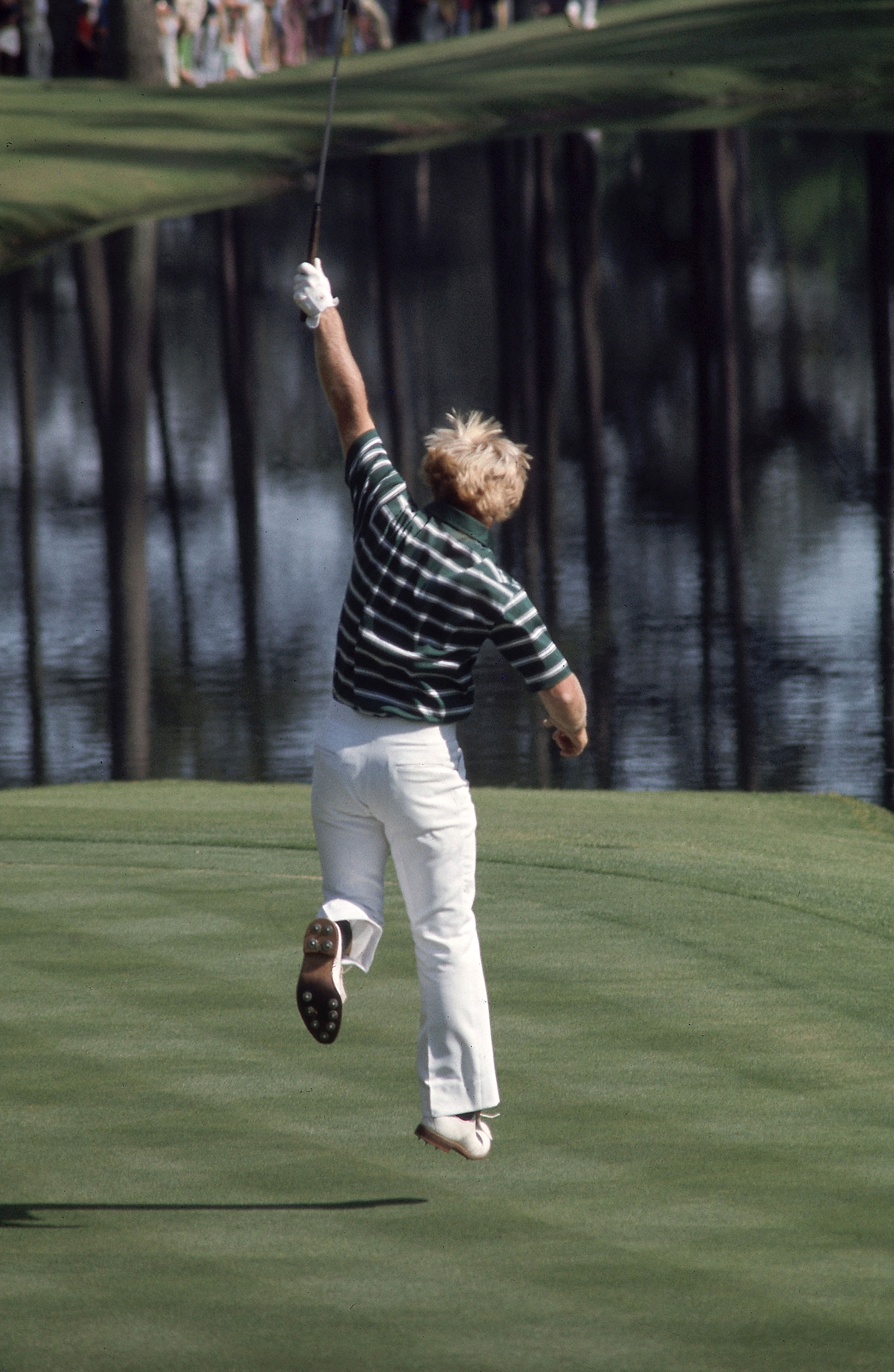 Jack Nicklaus - 1975                            The Golden Bear takes to the air after rolling in a 40-foot putt for birdie at 16 on Sunday. The putt ties Jack with Tom Weiskopf, who watches from the 16th tee as Nicklaus makes his putt. Weiskopf bogies the hole and Nicklaus finishes with two pars to secure his fifth green jacket.