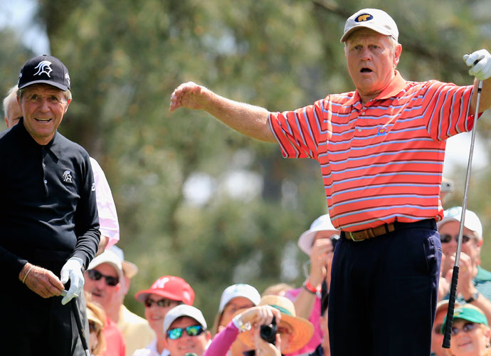 Jack Nicklaus and Gary Player share a laugh after a Nicklaus tee shot.
