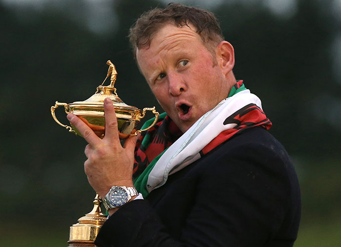 Jamie Donaldson, who secured the win for Europe, poses with the Samuel Ryder trophy.