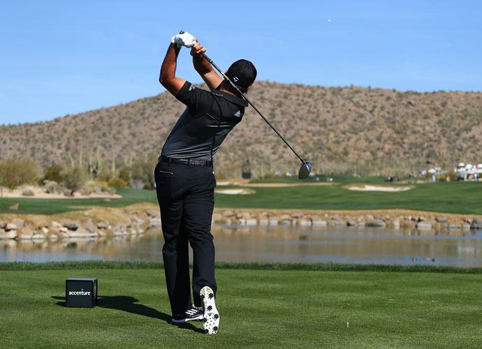 Jason Day follows through on his tee shot on the fourth hole. He will face Rickie Fowler in the semifinals.