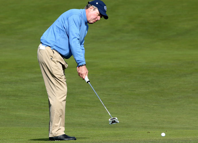 Former Florida governor Jeb Bush putts on the 12th hole during the first day of the pro-am.