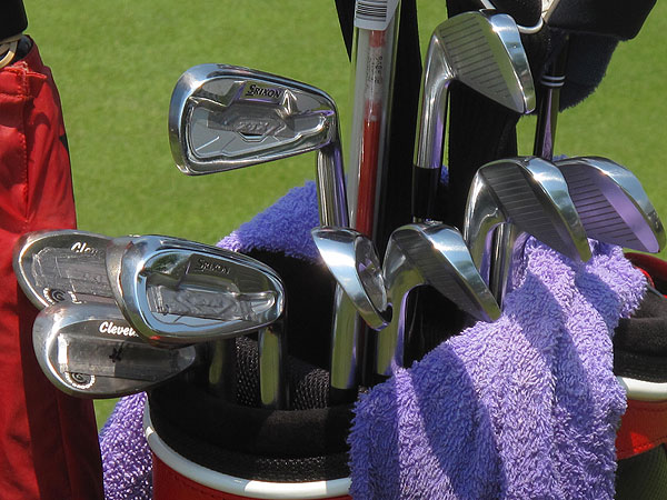 has several layers of lead tape added to his Srixon irons and Cleveland wedges.