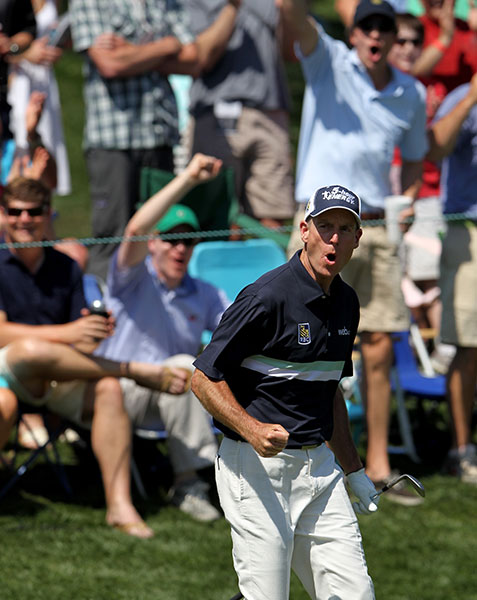 Jim Furyk celebrates his eagle on the 15th hole. Furyk finished second at 13-under, one stroke back of Holmes.