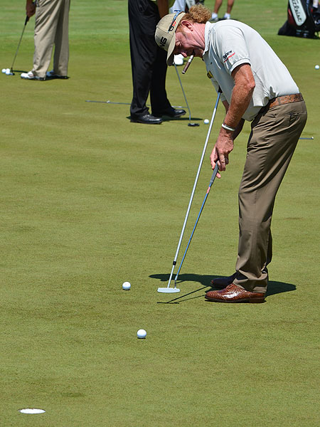 Miguel Angel Jimenez practiced his putting with a long shaft anchored between his chest and his Ping putter.