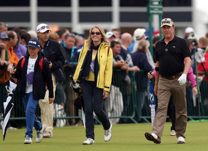 Miguel Angel Jimenez walks with his wife and son during his Wednesday practice round.