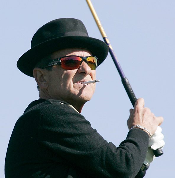 Actor Joe Pesci watches his shot during the first day of the Bob Hope Classic at Bermuda Dunes golf course in Bermuda Dunes, Calif., Wednesday, Jan. 17, 2006.