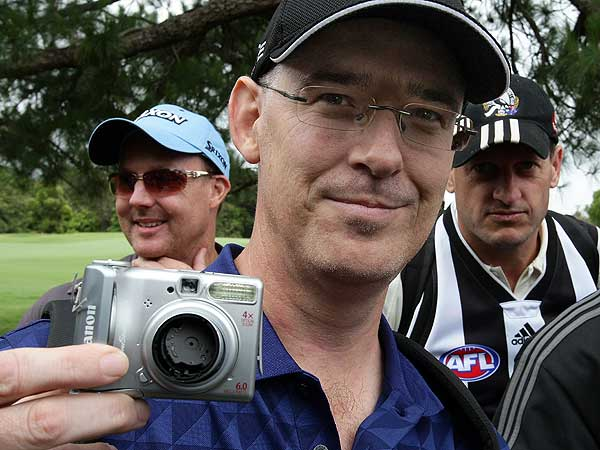Fan Brad Clegg displayed his camera after it was smashed against a tree by Daly during the opening round of the 2008 Australian Open. Daly lost his temper and grabbed the camera on the 18th hole after Clegg tried to take a photo of Daly. His score for the day was 78.