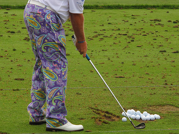 purple paisley pants may have been a tribute to Prince, a native son of Minneapolis. Daly's girlfriend was wearing a matching skirt.