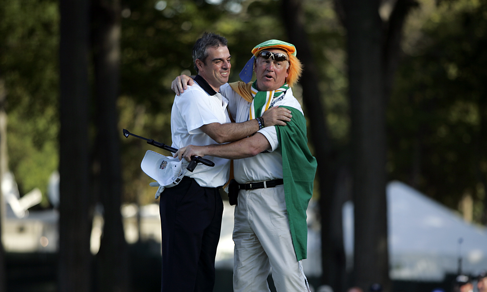 Irishman Paul McGinley embraced a countryman who rushed the green after McGinley's win in the '04 Ryder Cup at Oakland Hills.