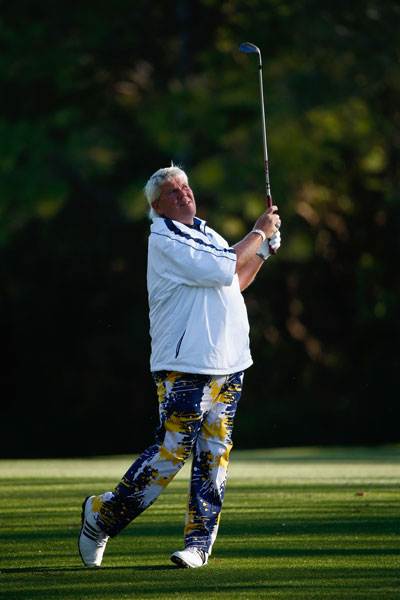 John Daly hits a shot on the seventh green. Long John shot a career-worst 90 that included a 12 on the 16th hole.