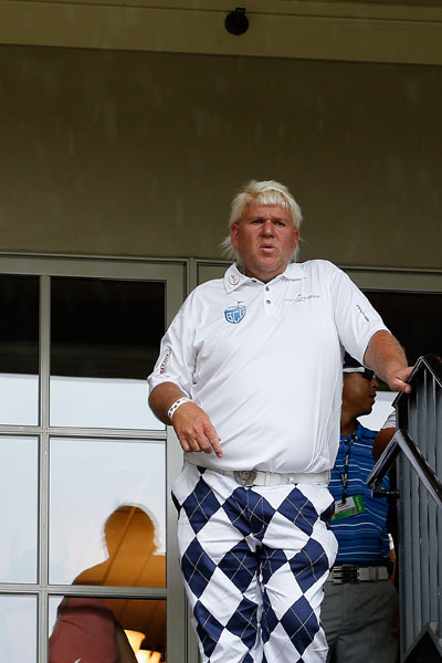 John Daly waits out the weather delay at TPC Southwind. He finished with a 2-over 72.