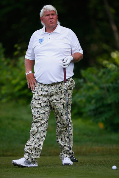 John Daly waits to hit his drive on the 12th tee. He shot 70-68 and made the cut at -2.