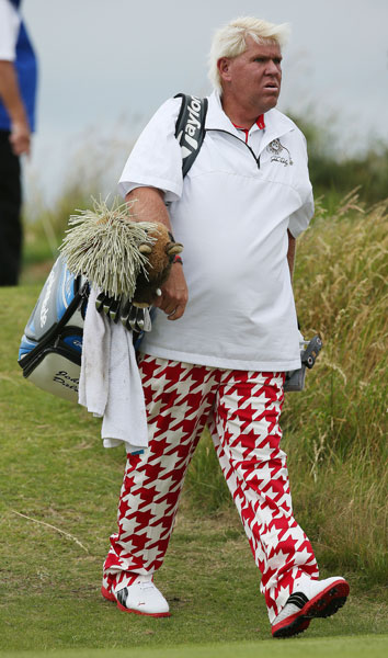 John Daly also toted his own bag.