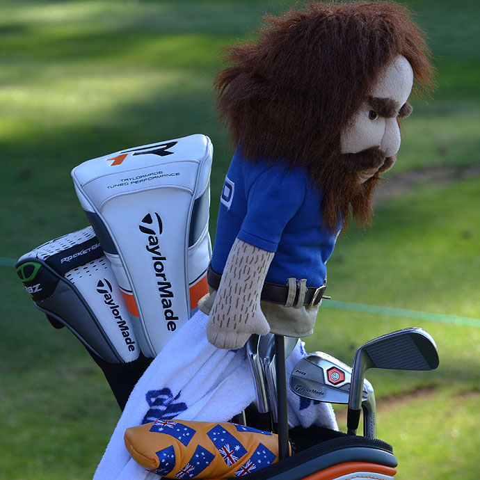 John Senden's TaylorMade R11 irons and R1 driver are watched over by a Geico caveman.
