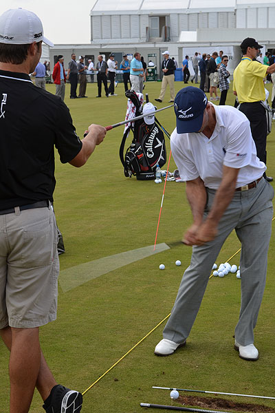Byrd employed the help of his caddie, a few golf shafts and an extra tee during a drill Monday morning.