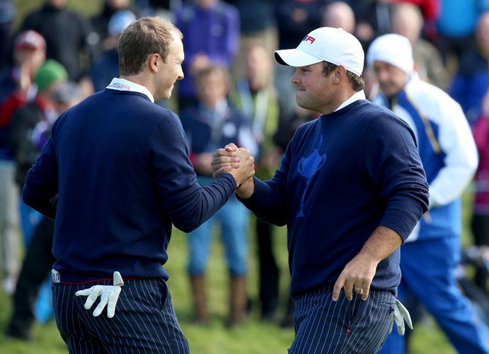 Jordan Spieth and Patrick Reed celebrate their win in morning four ball.