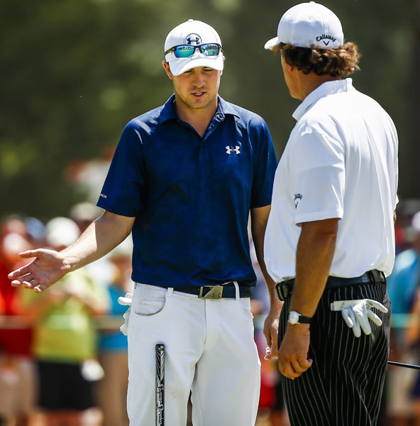 Jordan Spieth talks with Phil Mickelson on the 15th green during their practice round.