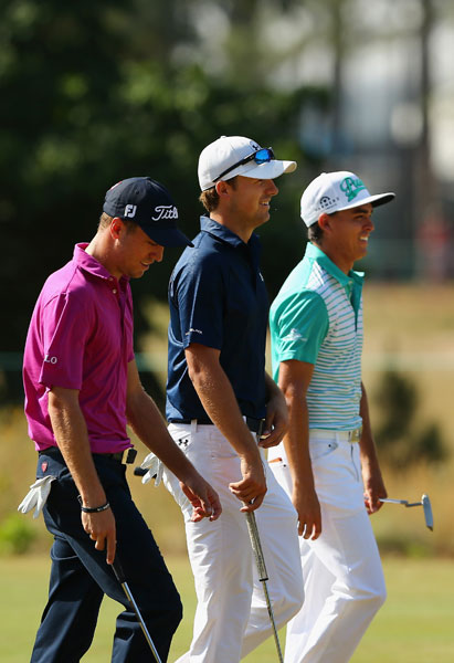 (From left) Justin Thomas, Jordan Spieth and Rickie Fowler walk together during their practice round.