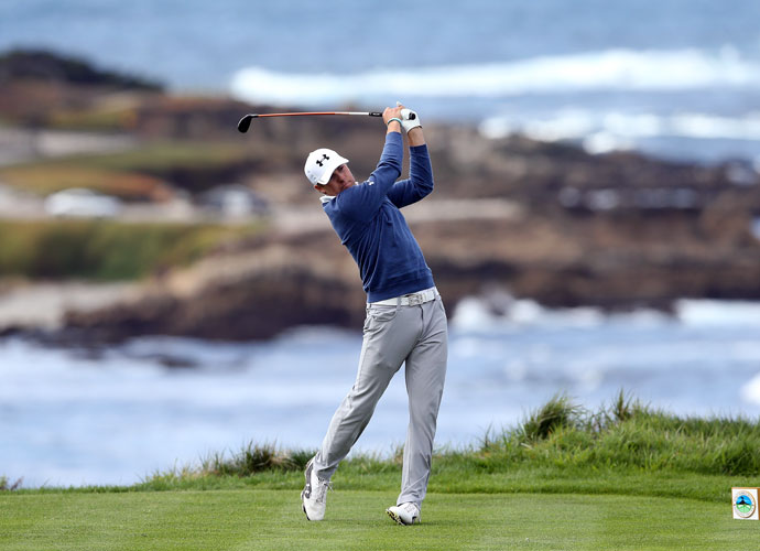 Jordan Spieth hits a tee shot on the fourth hole during the first round at Spyglass Hill Golf Course. Spieth shot a five-under 67, four shots back of leader Andrew Loupe.