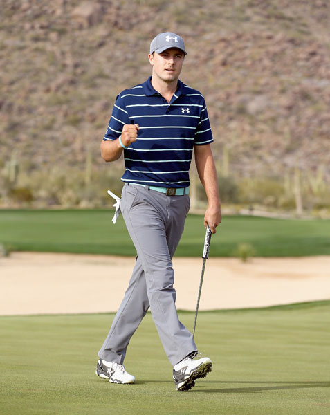 Jordan Spieth pumps his first after defeating defending champion Matt Kuchar, 2 & 1, in the third round.