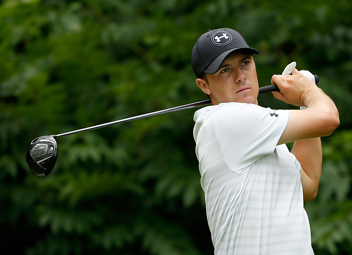 Jordan Spieth went four under on the day but also couldn't keep up with the lead.