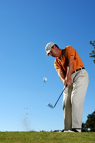 "How to Make Chips Check                       Use the 'slip' move to help short shots grab the green                                                                                                                     By Paul Marchand                       Top 100 Teacher                                              This story is for you if...                                              • You can chip the ball high but can't make it bite                                              • You often catch the shot fat when you try to follow the ""hit down to make the ball go up"" rule                                              The Situation                       You have a short chip to the hole, but the green runs away from you. You need height and spin to stop this close.                                              The Solution                       In this situation, Tour players hit a ""slip shot,"" and you can, too. It gives you extra height and a ton of backspin, so the ball sits in a hurry. Whereas most lob shots require you to hit down on the ball to produce height and spin, you only need to ""slip"" the clubhead under the ball on this one to get the results you want.                                              Follow the steps at right. This technique only works if you swing aggressively through the hitting zone — don't slow down or try to baby the ball into the air. Make some practice swings before you do it for real, and remember to stay aggressive and stop your follow-through at hip height."