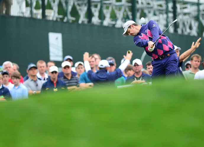 Justin Rose hits his tee shot on the 17th hole.