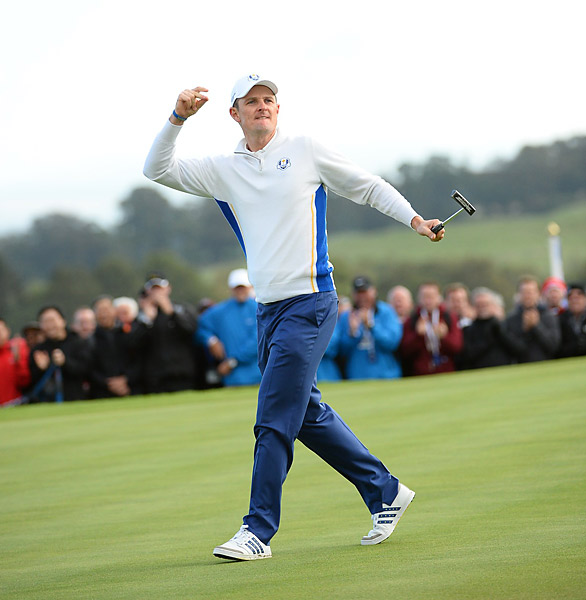 Justin Rose celebrates after sinking a putt during his win.