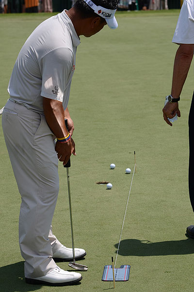 K.J. Choi practiced his putting Monday while using a mirror and a string to ensure his eyes were in the correct position at address. He uses an Odyssey White Hot #2.