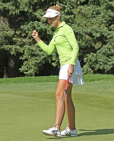 Ekey pumps her fist after making a birdie putt on the fifth hole during the third round of the CN Canadian Women's Open at Royal Mayfair Golf Club on August 24, 2013 in Edmonton, Alberta, Canada.