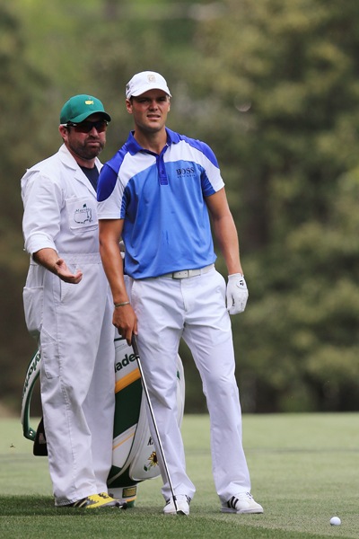 BEST: MARTIN KAYMER                           Kaymer is dressed in a blue iteration of Stenson's polo, which looks great on him. I like the cool blue and white colorblock swirls on the shoulders, and the white pants tie everything together to create a clean and appealing look.