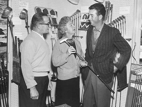"""That's me with my mother and father in the Harding Park pro shop, which my father managed. He was probably a 5- or 6-handicap, but he didn't play that much. He worked so hard. My mother sold some real estate on the side, but she also gave so much to junior golf. She gave Tony Lema his first pair of golf shoes. He was out at Harding, playing tennis in his sneakers one day, and she said, 'Where are your golf shoes? Get in here.' And she brought him in the shop and gave him shoes."""