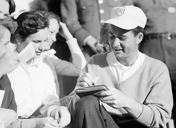 """This is the '56 Masters. We didn't do a lot of autograph signing in those days, but I'll tell you something — I'm from the old school. I'm one of the few whose signature you can actually read. You look at Ben Hogan, Byron Nelson, Sam Snead. You can read all their signatures. Today, I can show you a signed poster of my team I was captain of the Presidents Cup, and if I didn't have their pictures, I couldn't tell you who it was."""