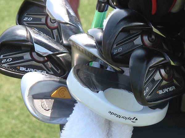 Kenny Perry is using TaylorMade's Burner 2.0 irons and a Cleveland CG14 lob wedge. He had several putters in the bag Tuesday afternoon, including the heavily-taped white TaylorMade Rossa Ghost you can see here.