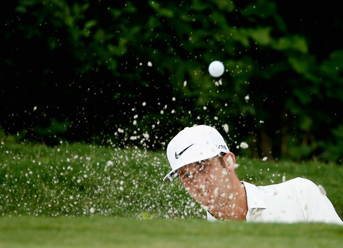 Kevin Chappell plays his shot out of the bunker on the 11th hole.