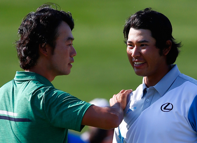 Na congratulates Matsuyama on his playoff victory. Matsuyama headed to the 18th needing a birdie to force a playoff and delivered with his fourth straight birdie on Muirfield Village's final hole.