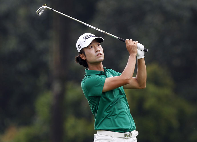 Kevin Na shot a bogey-free 67 to earn a share of the lead headed to the final round.