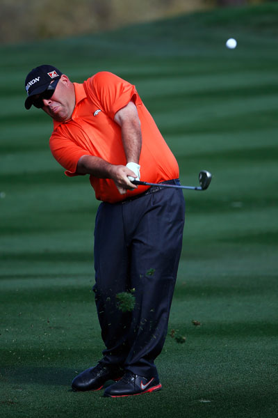 Kevin Stadler hits a shot on the second hole during the third round of the Waste Management Phoenix Open. Stadler shot 67 (-13) to enter the final round alone in second, two shots behind Bubba Watson.