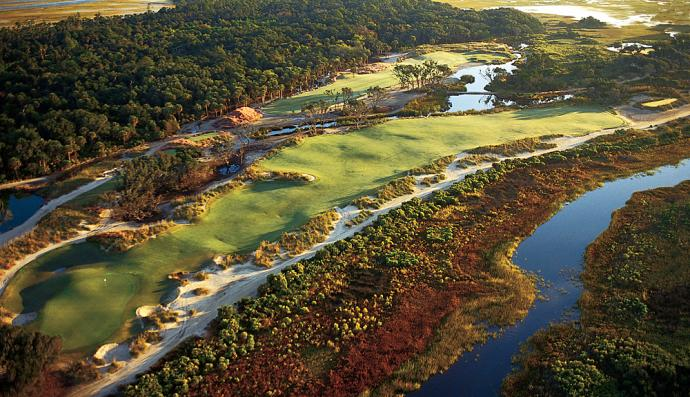 """Kiawah Island Ocean Club                           Hole 9, 494 yards, Par 4 The outward nine ends on a demanding two-shotter surrounded by trouble. """"The big deal on this hole is that the green is a little bit offset, so the ball has to be turning right to left on the second shot or they'll have to carry it to the green,"""" says architect Pete Dye. On a fast, windy day, that might mean a third from the deep pot bunker over the green. (Source: KiawahResort.com)"""