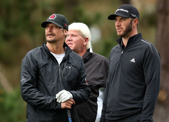 Kid Rock, John Daly and Dustin Johnson stand at the 17th tee in the first round.
