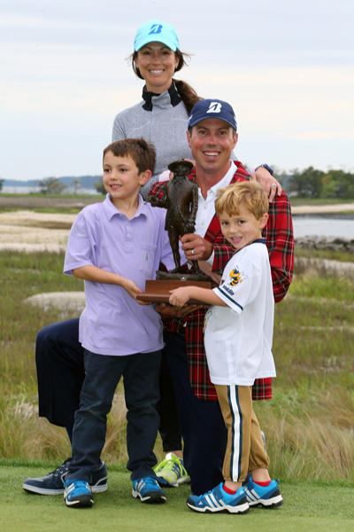 Kuchar, poses with his family after the victory, his seventh on the PGA Tour.