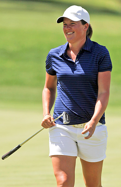 Karin Sjodin surged into a tie for the lead with a 67 in tough conditions.
