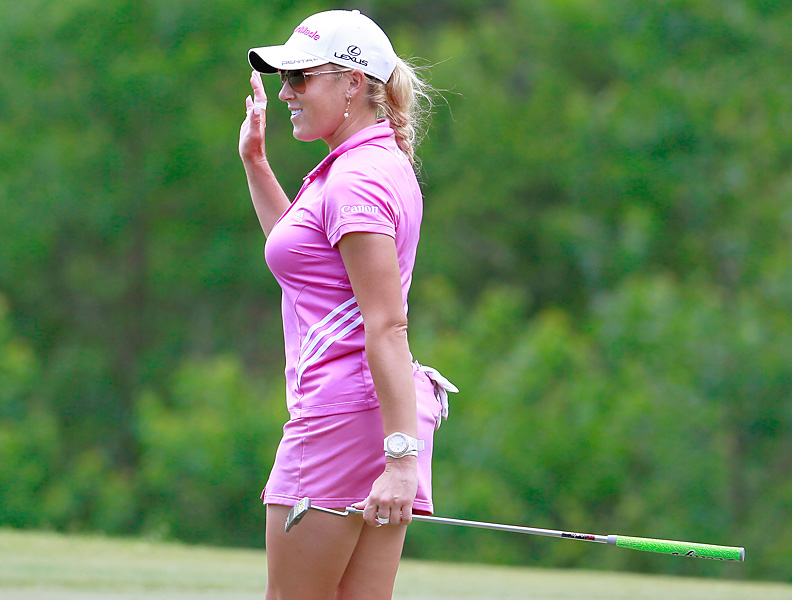 """Natalie Gulbis has always been fashion-conscious. At the Mobile Bay LPGA Classic, she wore a series of even-more-eye-catching-than-normal skirts (or are they """"skorts""""?), which were approaching scandalously short."""
