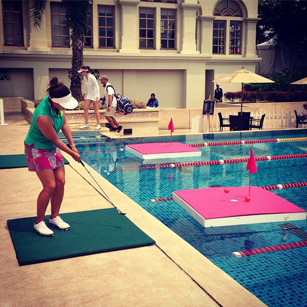 @lpga_tour Mariajo Uribe tries out the Chip 4 Charity set up at the pool during the @simedarbylpga #womenwithdrive