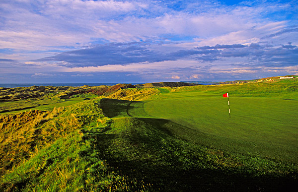 "Hole No. 4                           Royal Portrush (Dunluce)                           Portrush, Northern Ireland                           14th hole; par 3, 213 yards                                                      The most aptly named hole on the Dream 18 is ""Calamity""-the stomach-churning signature hole at Royal Portrush. It's all carry to the green over a yawning, 75-foot chasm. A ""safe"" play to the left could leave you buried in heather-choked hillocks. The innocent-looking, flattish green holds its own brand of terrors: Tom Kite three-putted here in the 2004 Senior British Open and eventually finished one shot behind champion Pete Oakley."