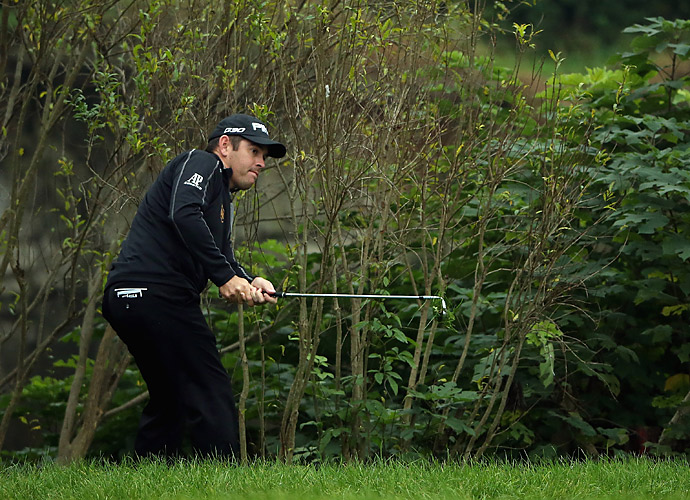 Louis Oosthuizen was forced to hit left-handed after finding trouble on the 17th hole.